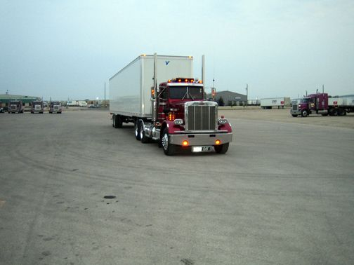view of a truck in open grounds